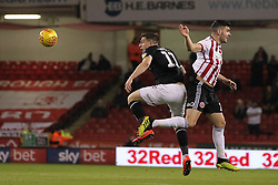 February 13, 2019 - Sheffield, South Yorkshire, United Kingdom - SHEFFIELD, UK 13TH FEBRUARY  Jordan Hugill of Middlesbrough contests a header with John Egan of Sheffield United during the Sky Bet Championship match between Sheffield United and Middlesbrough at Bramall Lane, Sheffield on Wednesday 13th February 2019. (Credit: Mark Fletcher | MI News) (Credit Image: © Mi News/NurPhoto via ZUMA Press)