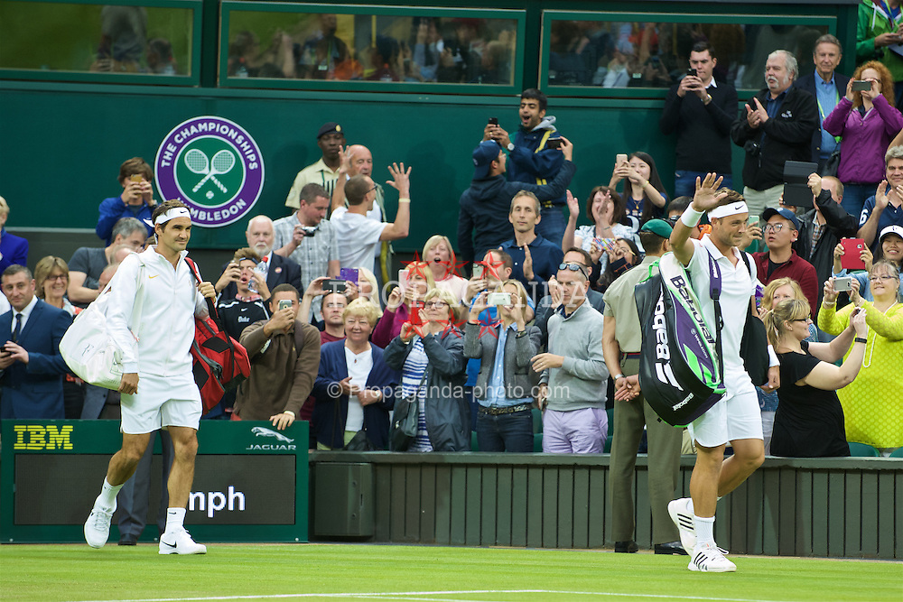 LONDON, ENGLAND - Wednesday, June 29, 2016: Marcus Willis (GBR) walks onto Centre Court followed by Roger Federer (SUI) during the Gentlemen's Single 2nd Round match on day three of the Wimbledon Lawn Tennis Championships at the All England Lawn Tennis and Croquet Club. (Pic by Kirsten Holst/Propaganda)