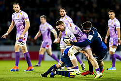 Sam Simmonds of Exeter Chiefs is tackled - Mandatory by-line: Robbie Stephenson/JMP - 08/12/2019 - RUGBY - AJ Bell Stadium - Manchester, England - Sale Sharks v Exeter Chiefs - Heineken Champions Cup