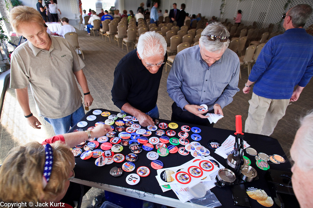 Feb. 17, 2010 -- GOLD CANYON, AZ: People buy campaign buttons at a JD Hayworth campaign rally in Gold Canyon, AZ. Hayworth, a former television sports anchor and an ultra conservative former Representative who lost his congressional seat to a moderate Democrat in 2006, is running in the Republican primary against long serving Republican Senator John McCain. Hayworth is popular with the Tea Party activists of the Phoenix suburbs.  Photo By Jack Kurtz