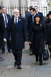© Licensed to London News Pictures. 10/11/2019. London, UK. Leader of the Labour Party, Jeremy Corbyn and his wife, Laura Alvarez walks through Downing Street to attend the Remembrance Sunday Ceremony at the Cenotaph in Whitehall. Remembrance Sunday events are held across the country today as the UK remembers and honours those who have sacrificed themselves in two world wars and other conflicts. Photo credit: Vickie Flores/LNP
