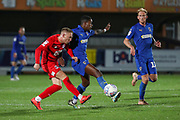 AFC Wimbledon attacker Michael Folivi (17) battles for possession with Leyton Orient defender Myles Judd (14) during the Leasing.com EFL Trophy match between AFC Wimbledon and Leyton Orient at the Cherry Red Records Stadium, Kingston, England on 8 October 2019.
