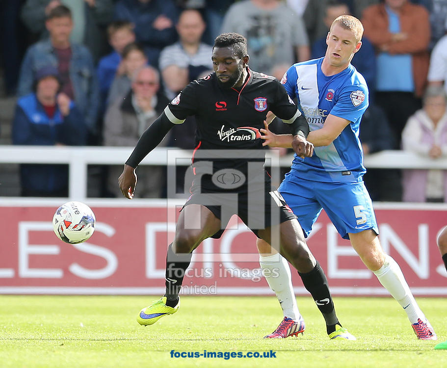 Scott Harrison (r) of Hartlepool United and Jabo Ibehre (l) of Carlisle United during the Sky Bet League 2 match at Victoria Park, Hartlepool<br /> Picture by Simon Moore/Focus Images Ltd 07807 671782<br /> 29/08/2015