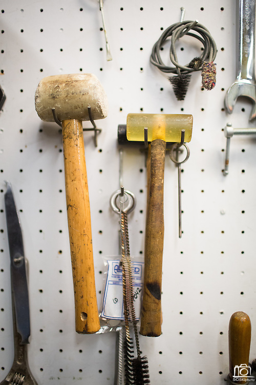 Tools hang on the wall in the Allegro Music repair shop at Allegro Music in Fremont, California, on April 16, 2014. (Stan Olszewski/SOSKIphoto)
