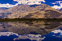 Reflections from surrounding peaks in the remote Nubra Valley of Ladakh, Jammu and Kashmir State, India.