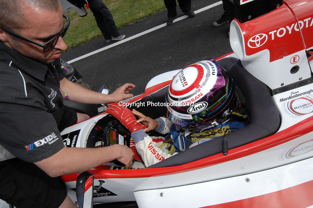 Jann Mardenborough from the UK is strapped into his Toyota FT40 for the start of the Grand Prix.