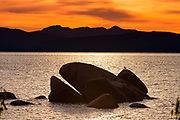 Lake Tahoe sunset over the famous whale rock at Whale Beach near Incline Village, Nev., USA.
