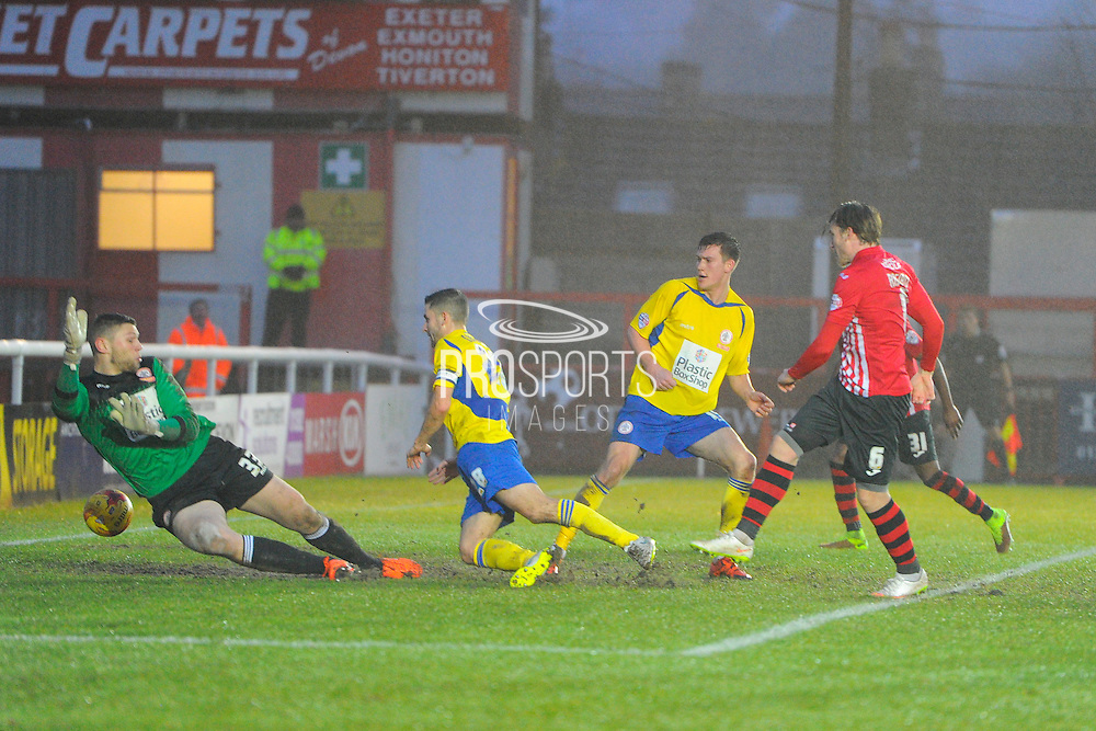 Goal.  Exeter City's Christian Ribeiro beats Accrington Stanley's Ross Etheridge to give Exeter the lead during the Sky Bet League 2 match between Exeter City and Accrington Stanley at St James' Park, Exeter, England on 23 January 2016. Photo by Graham Hunt.