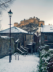 View of Edinburgh Castle after snow from the historic Vennel steps at Grassmarket in Edinburgh Old Town, Scotland, United Kingdom
