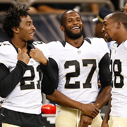 Aug 28, 2014; New Orleans, LA, USA; New Orleans Saints cornerback Patrick Robinson (21) and cornerback Champ Bailey (27) and cornerback Keenan Lewis (28) talk on the sideline during the second half of a preseason game against the Baltimore Ravens at Mercedes-Benz Superdome. The Ravens defeated the Saints 22-13. Mandatory Credit: Derick E. Hingle-USA TODAY Sports