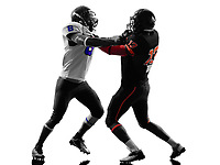 two american football players on scrimmage holding in silhouette shadow white background
