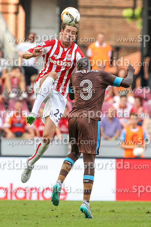 02.08.2015, Rhein Energie Stadion, Koeln, GER, Testspiel, Stoke City vs FC Porto, im Bild Peter Crouch (Stoke City FC #25) im Kopfballduell gegen Bruno Martins Indi (FC Porto #3) // during the International Friendly Football Match between Stoke City and FC Porto at the Rhein Energie Stadion in Koeln, Germany on 2015/08/02. EXPA Pictures &copy; 2015, PhotoCredit: EXPA/ Eibner-Pressefoto/ Schueler<br /> <br /> *****ATTENTION - OUT of GER*****