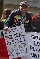 London, May 1st 2016. A pensioner demands a fair deal for the NHS as members of various trade unions and workers' groups march through London on May Day, International Workers' Day. ©Paul Davey<br /> FOR LICENCING CONTACT: Paul Davey +44 (0) 7966 016 296 paul@pauldaveycreative.co.uk