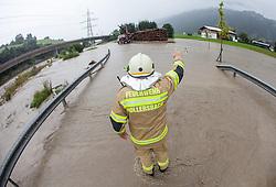 31.07.2014, B165, Hollersbach, AUT, Hochwasser in Oesterreich, Salzburg, im Bild Feuerwehrleute bei der Strassensperre in Hollersbach. EXPA Pictures © 2014, PhotoCredit: EXPA/ JFK