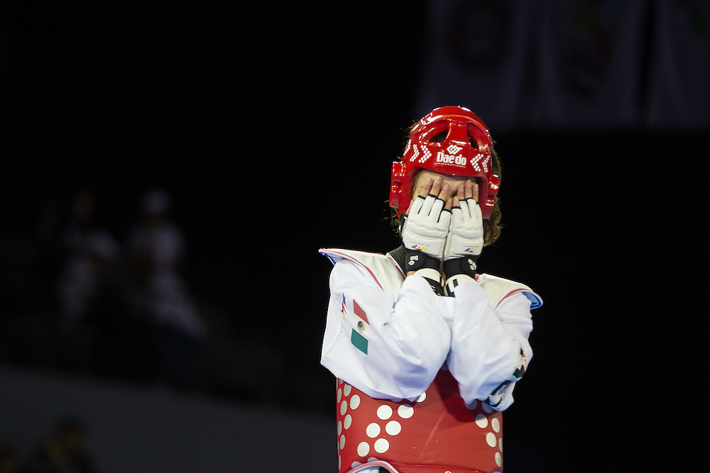 Victoria Heredia of Mexico celebrates after defeating Katherine Alvarado of Costa Rica in their semi-final contest in women's taekwondo -67 kg division at the 2015 Pan American Games in Toronto, Canada, July 21,  2015.  AFP PHOTO/GEOFF ROBINS