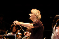 UK. London. Conductor, Sir Simon Rattle, during rehersals of Wagner's Das Rheingold, which, together with the Orchestra of The Age of Enlightenment, launch the Proms' first ever Ring Cycle as part of the BBC's Proms, in London's Royal Albert Hall..