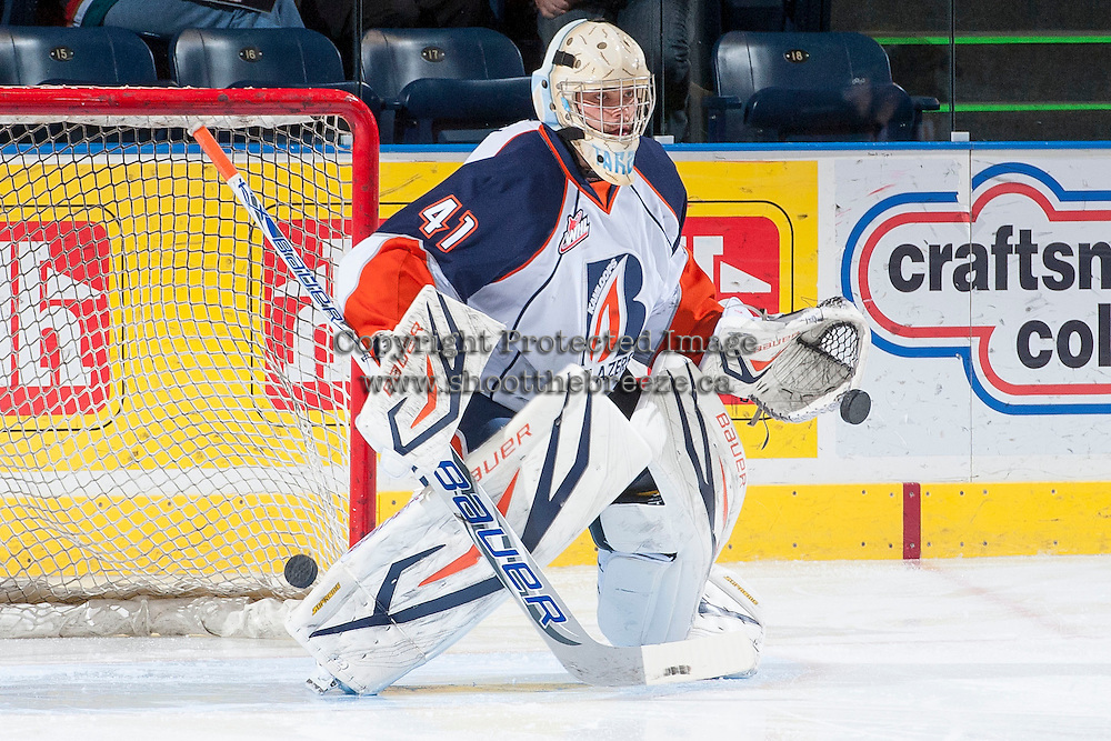 KELOWNA, CANADA - NOVEMBER 30: Taran Kozun #41 of the Kamloops Blazers warms up in net against the Kelowna Rockets on November 30, 2013 at Prospera Place in Kelowna, British Columbia, Canada.   (Photo by Marissa Baecker/Shoot the Breeze)  ***  Local Caption  ***