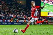 Charlton Athletic midfielder Chris Solly (20) takes the first penalty during the EFL Sky Bet League 1 second leg Play-Off match between Charlton Athletic and Doncaster Rovers at The Valley, London, England on 17 May 2019.