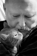 Lee Entwisle and his cat in Brooklyn, NY. He has two cats that provide companionship. Lee, who has had both legs amputated due to exposure to Agent Orange while serving in the Navy in Vietnam, is virtually housebound.