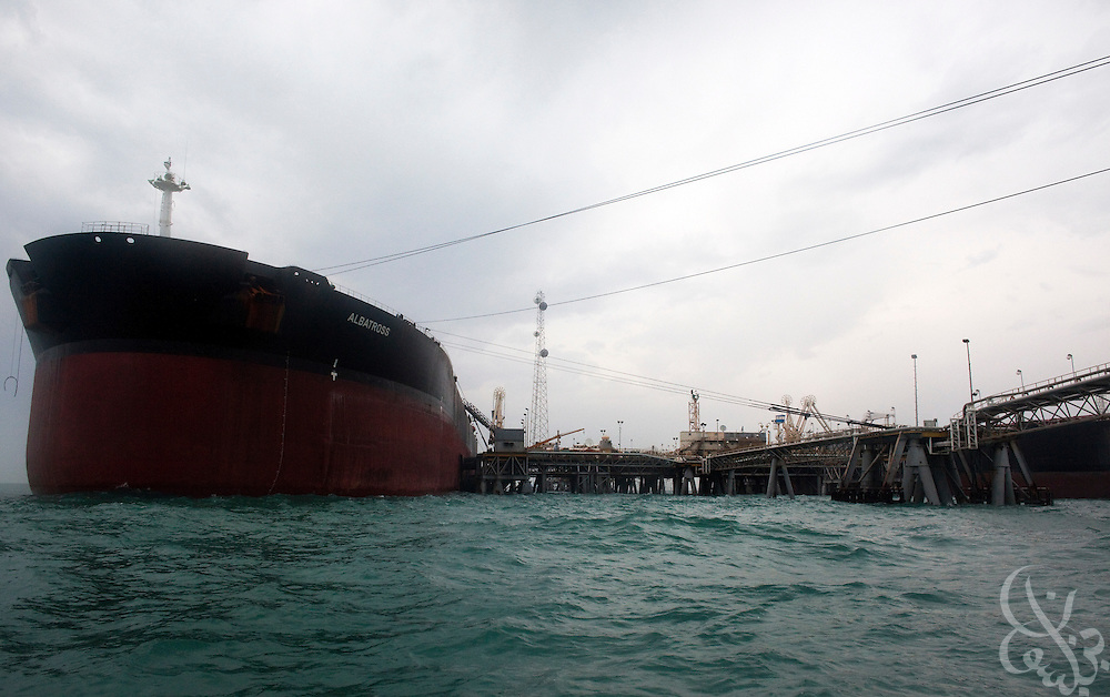 Tankers are filled with Iraqi oil at the Al Basrah oil terminal (ABOT) 50 kilometers off the coast of Iraq in the Northern Arabian Gulf February 3, 2010. Iraqi oil exports account for an estimated 75 percent of the country's GDP, and an estimated 85-90 percent of all Iraqi oil exports  come out through this vital terminal originally constructed in the 1970's.