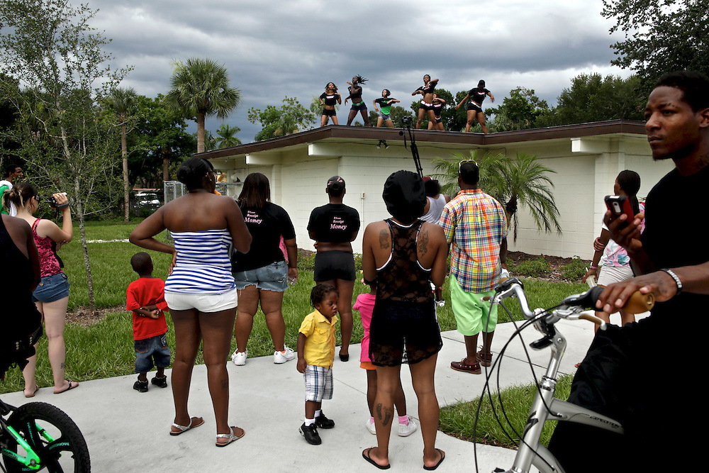 A crowd gathers to watch Fort Myers hip hop artists TimWes and Gutta Slim record a video at Clemente Park in Fort Myers. Local artists often collaborate on songs. Although, many will say that there is no unity.