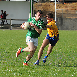 Achill&rsquo;s Tiorlach  is challenged by Knockmore&rsquo;s  during the junior champonship match in Achill on saturday evening.<br /> Pic Conor McKeown