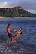 Couple, Waikiki Beach, Waikiki, Oahu, Hawaii, USA<br />