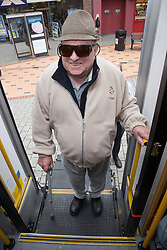 Man using platform lift to access mobile resource unit,