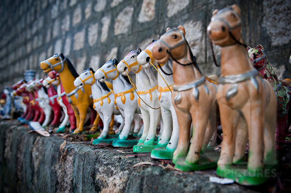 Miniature horses statues are lined up along a wall. Long Son pagoda, Nha Trang, Vietnam, Asia