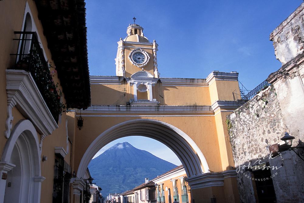 Santa Catalina arch, Antigua, Guatemala. Volcan de Agua in background.