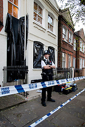 © London News Pictures. 11/11/2012. London, UK. A police officer guarding the crime scene at a property on Hazlebury Road, Fulham, south west London, where the body of a 73-year-old man was discovered after a violent attack. A murder inquiry has been launched by police after the body of a  severely injured pensioner was found during a call-out to a burglary. Photo credit: Ben Cawthra/LNP