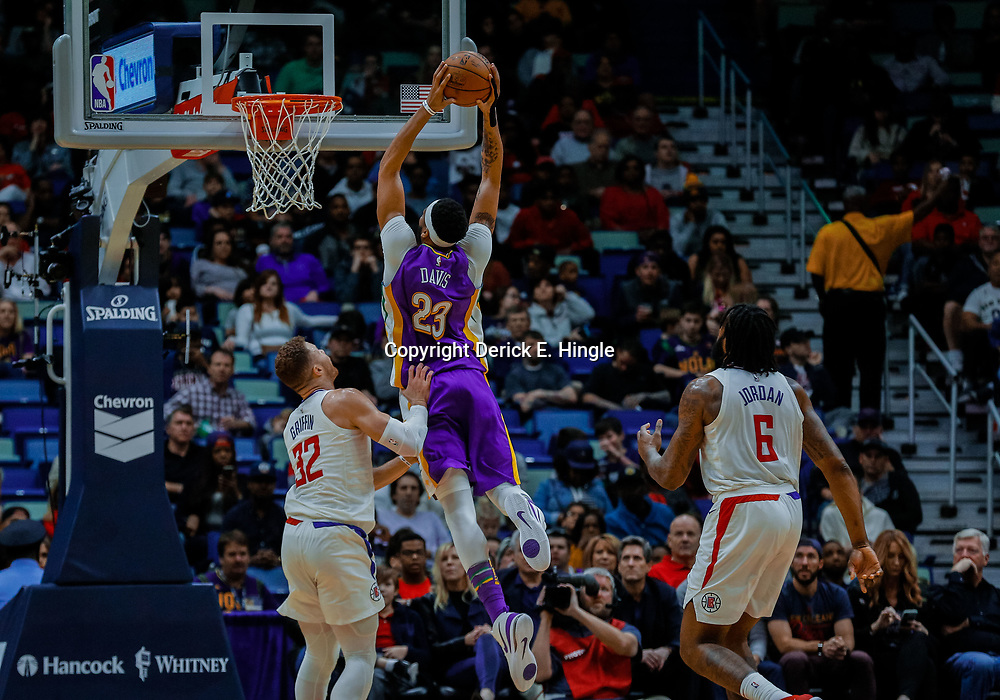 Jan 28, 2018; New Orleans, LA, USA; New Orleans Pelicans forward Anthony Davis (23) dunks over LA Clippers forward Blake Griffin (32) during the second quarter at the Smoothie King Center. Mandatory Credit: Derick E. Hingle-USA TODAY Sports
