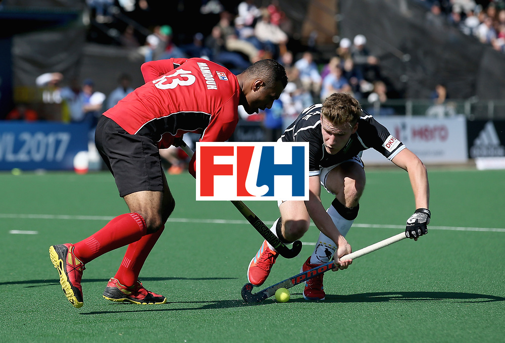 JOHANNESBURG, SOUTH AFRICA - JULY 11: Ferdinand Weinke of Germany and Mohamed Mamdouh of Egypt battle for possession  during day 2 of the FIH Hockey World League Semi Finals Pool B match between Germany and Egypt at Wits University on July 11, 2017 in Johannesburg, South Africa. (Photo by Jan Kruger/Getty Images for FIH)