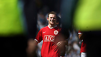 Photo: Paul Thomas.<br /> Manchester City v Manchester United. The Barclays Premiership. 05/05/2007.<br /> <br /> Wayne Rooney of Utd comes down to thank the Utd fans who were blocked by stewarts from getting too close!