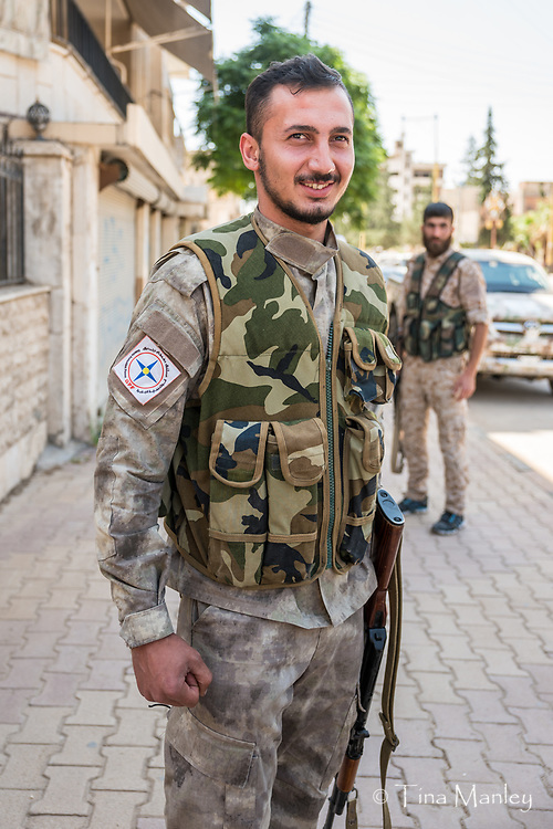 The Civil Guard keeps watch during church services in Kamishli, Syria.