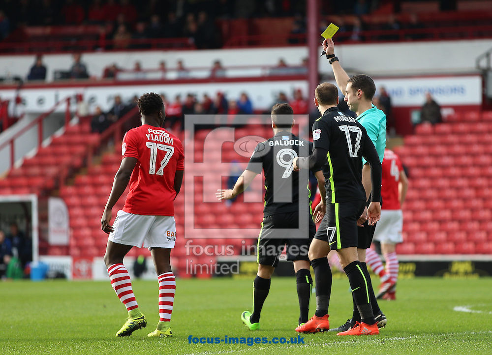Sam Baldock (middle) of Brighton &amp; Hove Albion is booked for diving during the Sky Bet Championship match at Oakwell, Barnsley<br /> Picture by James Wilson/Focus Images Ltd 07709 548263<br /> 18/02/2017