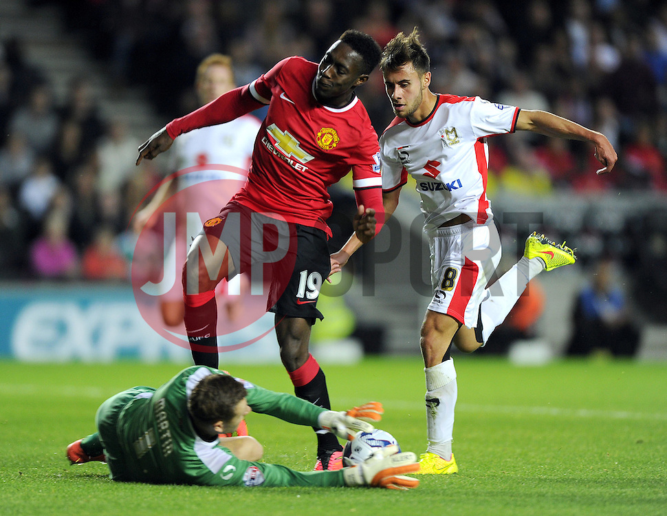 Manchester United's Danny Welbeck battles for the ball with Milton Keynes Dons' George Baldock - Photo mandatory by-line: Joe Meredith/JMP - Mobile: 07966 386802 26/08/2014 - SPORT - FOOTBALL - Milton Keynes - Stadium MK - Milton Keynes Dons v Manchester United - Capital One Cup