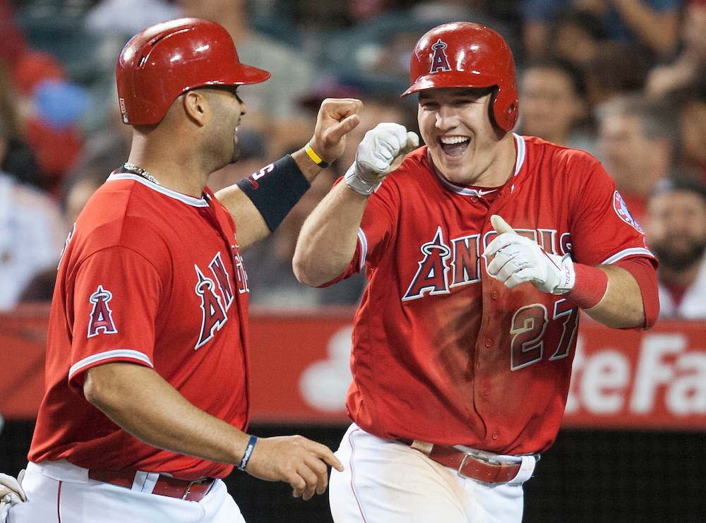 The Angels' Albert Pujols celebrates with Mike Trout after they scored on a C.J. Cron double in the sixth inning Wednesday night at Angel Stadium.<br /> <br /> <br /> ///ADDITIONAL INFO:   <br /> <br /> angels.0616.kjs  ---  Photo by KEVIN SULLIVAN / Orange County Register  -- 6/15/16<br /> <br /> The Los Angeles Angels take on the Minnesota Twins Wednesday at Angel Stadium.