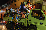 A truck full of people traveling at night in Granada, Nicaragua