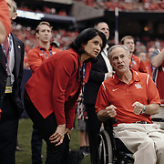 Texas governor Greg Abbott and University of Houston president, Renu Khator, watch the game.<br /> <br /> Todd Spoth for The New York Times.