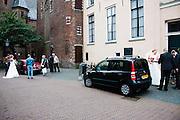 Twee bruiden staan te wachten achter de Dom in Utrecht.<br /> <br /> Two brides are waiting in the center of Utrecht.