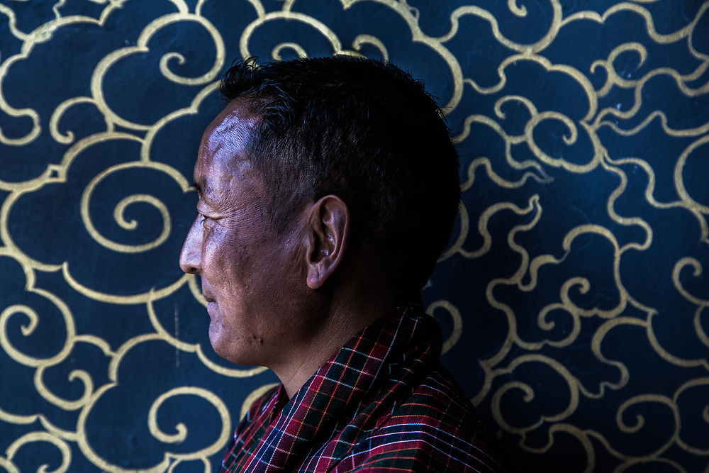 A portrait of local man in a temple, Bhutan