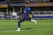 AFC Wimbledon goalkeeper Nathan Trott (1) wamring up and  about to kick the ball during the Leasing.com EFL Trophy match between AFC Wimbledon and Leyton Orient at the Cherry Red Records Stadium, Kingston, England on 8 October 2019.