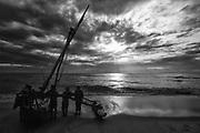 Sri Lanka.<br /> Launching a boat at dawn.<br /> East coast - Thirukovil.