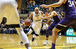 Feb 12, 2018; Morgantown, WV, USA; West Virginia Mountaineers guard Jevon Carter (2) drives down the lane during the second half against the TCU Horned Frogs at WVU Coliseum. Mandatory Credit: Ben Queen-USA TODAY Sports