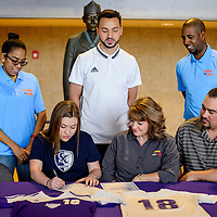 Toni Garcia sits with her parents, coach and scouts as she signs a letter of intent to play soccer for Sterling College Thursday at Miyamura High Schoo.