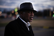 "MONTGOMERY, AL – JANUARY 25, 2016: Michael Harris, 52, waits for clients outside the new Greyhound station on South Boulevard. In 2011, the downtown Montgomery Greyhound bus station was converted into a museum to honor the freedom riders, who endured a violent attack there in 1961. The replacement bus station, located four miles from downtown, is a prime business opportunity for independent cabbies like Michael Harris, who make a living serving passengers unwilling to rely on city buses. Many characterize the public bus system in Montgomery as unsafe and unreliable, so wary passengers cough up $2 per mile for trips in Mr. Harris' 2005 Lincoln Navigator, traveling across town for fast food, or sometimes as far as New York City. ""This is my life,"" Harris said. ""I love driving, and I help people out. It's just in my heart."""