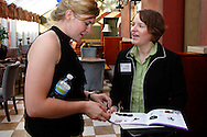 WiBN intern Brittany Catalenas (left) and Stefani Ruiz of Custom Incentives during a BBB/Women in Business Networking event in the atrium of the Kuhn Building in downtown Dayton, Thursday, July 14, 2011.