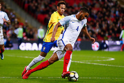 Brazil Paris Saint Germain PSG midfielder Neymar (10) chases down England Liverpool defender Joe Gomez (4)  during the International Friendly match between England and Brazil at Wembley Stadium, London, England on 14 November 2017. Photo by Simon Davies.