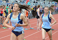 North Penn's Michaela Vlasic (left) runs after receiving a handoff from Jenna Webb in the 4x800 relay during the Central Bucks West Relays at Central Bucks West High School Saturday April 23, 2016 in Doylestown, Pennsylvania. (Photo by William Thomas Cain)
